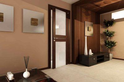 Безрамный тип межкомнатной двери, которая представлена элементами из дерева в темной цветовой гамме и полупрозрачнными массивными стеклянными вставками