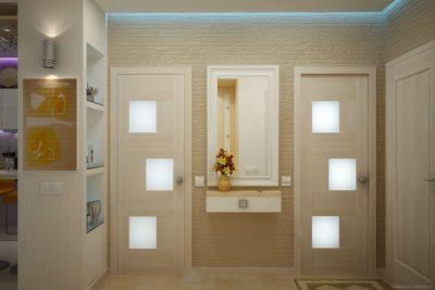 Лаконичные модели дверных конструкций, которые оформлены в молочной древесной цветовой гамме, дополнительно декорированные вставками из матового стекла